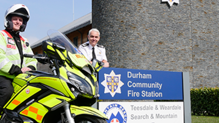 photo of Blood bikes rider and CFO Stuart Errington in front of fire station