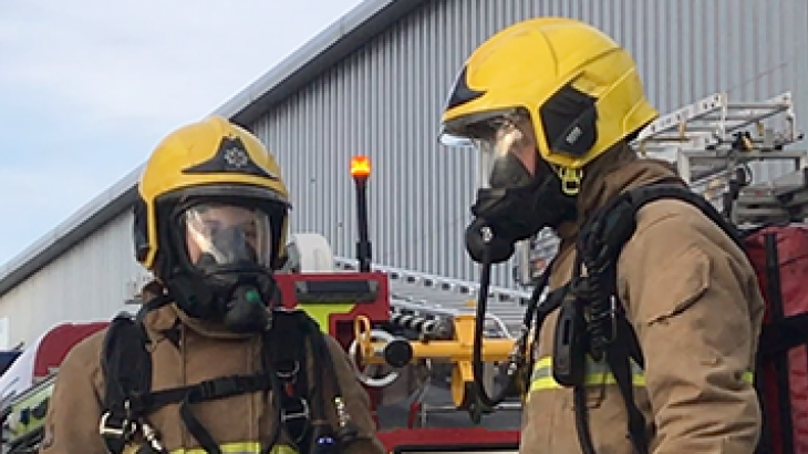 firefighters in breathing aparatus