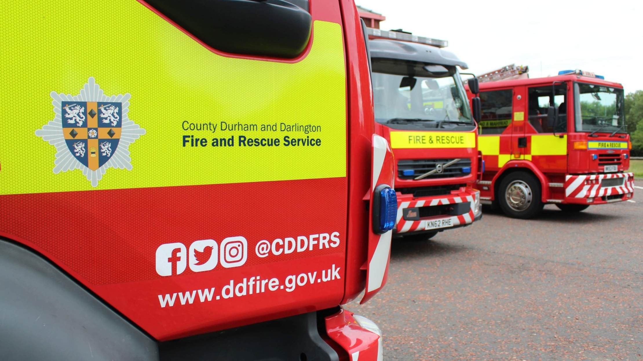 side of a fire appliance with website address and logo